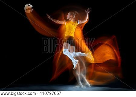 Young Female Volleyball Player Isolated On Black Studio Background In Mixed Light. Woman In Sportswe