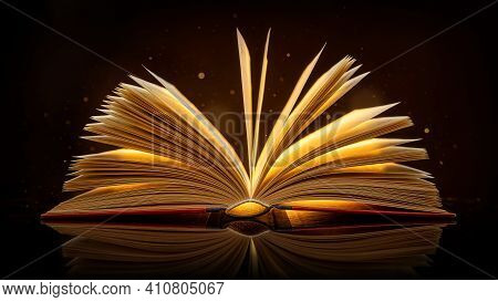 Close Up Of An Open Book With Glowing Light