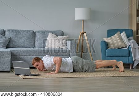 Self-care During Stay At Home. Fitness Training, Stretching Exercises Online Men At Home With Laptop