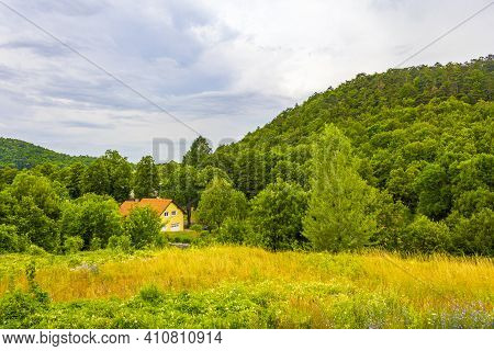 Wonderful Mountain And Forest Landscape With Idyllic Village In Slovenia.