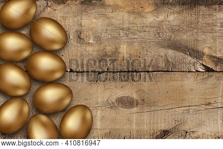 Golden Easter Eggs On A Wooden Table. Gold Easter Eggs On Wooden Background, Decoration. Rustic Back