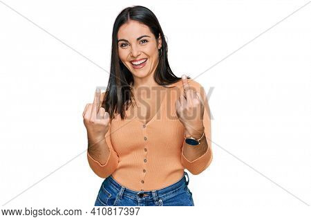 Young hispanic woman wearing casual clothes showing middle finger doing fuck you bad expression, provocation and rude attitude. screaming excited