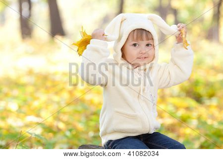 Beautiful Little Girl In Costume Bunny In The Autumn Forest