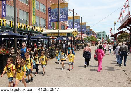 Chicago, Usa - June 26, 2013: People Visit The Navy Pier In Chicago. The 3,300-foot Pier Built In 19