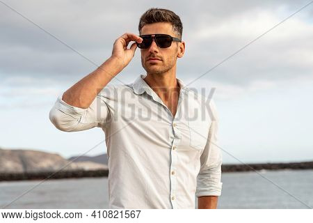 Gorgeous Stylish Man Wearing Fashionable Shirt And Sunglasses. City Style. Beautiful And Charming Ma