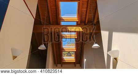 View Of Ceiling Of Gable Roof Without Attic With Three Plastic Windows, Finished With Clapboard,wood