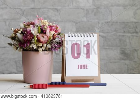 June 01. 01Th Day Of The Month, Calendar Date.a Delicate Bouquet Of Flowers In A Pink Vase, Two Penc