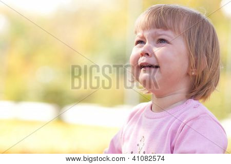 Beautiful Little Girl Crying On The Autumn Forest