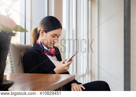 Side View Of Young Woman Using Smartphone Device, Female Receptionist Hands Typing Text Message Via