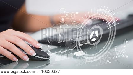 Financial data processing with icons over woman using computer. global business and finance concept digitally generated image.