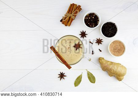 A Cup Of Masala Tea On Dark Wooden Background. Traditional Indian Tea Drink With Milk And Spices: Ci
