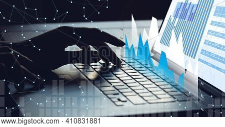 Financial data processing over woman using laptop. global business and finance concept digitally generated image.