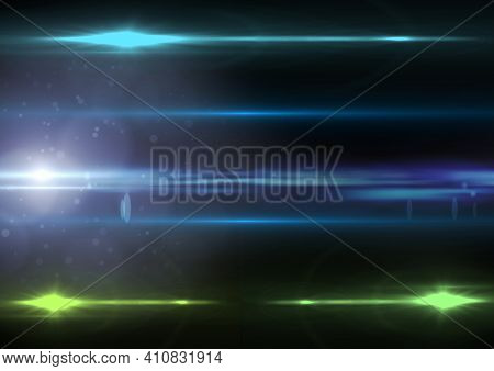 Glowing blue and green spots of light with light trails on black background. light and colour concept digitally generated image.