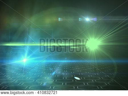 Glowing blue and green spots of light over computer circuit board elements. light, colour and technology concept digitally generated image.