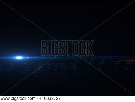 Glowing blue spot of light with light trail on black background. light and colour concept digitally generated image.