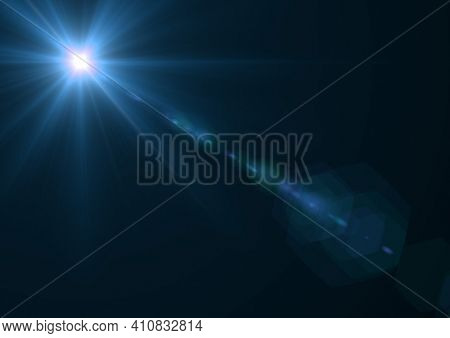 Glowing blue spot of light and light trails over blue background. light and colour concept digitally generated image.