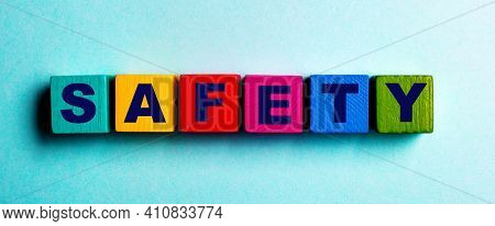 The Word Safety Is Written On Multicolored Bright Wooden Cubes On A Light Blue Background