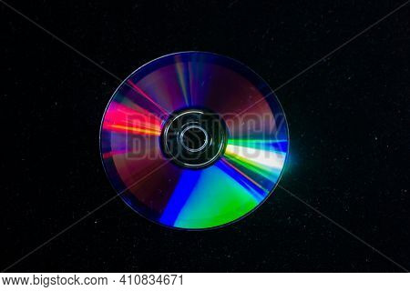 Cd Dvd Isolated On Black, Cd Dvd Background, Disk In The Dark