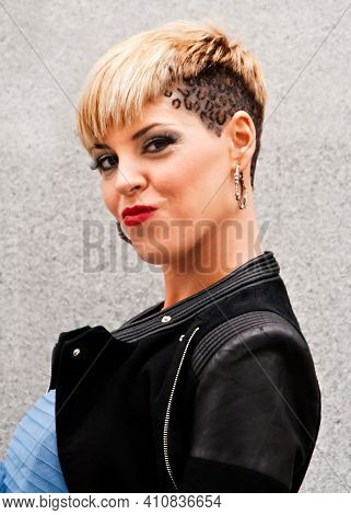 Young Woman In Style Of Urban Fashion.short Blonde Leopard Skin Hairstyle. Dressed With Motorcycle B
