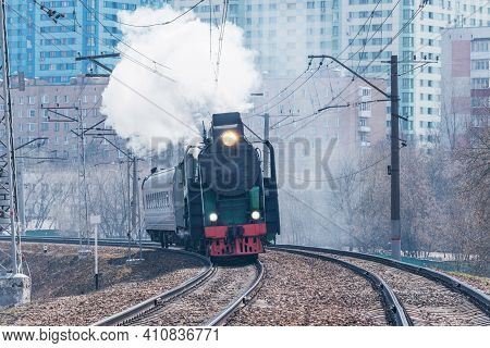 Retro Train Moves On The City Background.