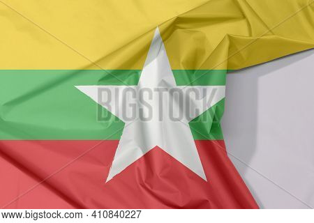 Myanmar Fabric Flag Crepe And Crease With White Space, Red Green And Yellow Color And White Star.