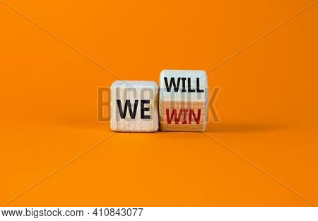 We Will Win Symbol. Turned A Wooden Cube And Changed Words We Will To We Win. Beautiful Orange Backg