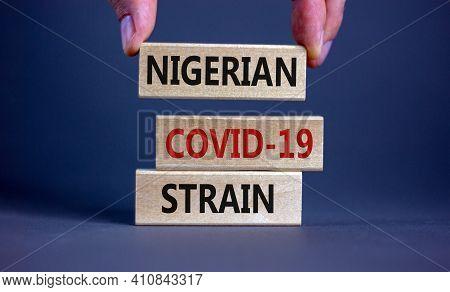 Covid-19 New Nigerian Strain Symbol. Doctor Holds Wooden Block, Words 'nigerian Covid-19 Strain'. Be