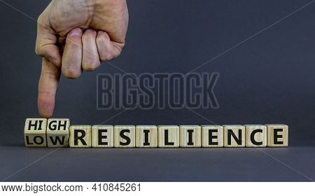 High Or Low Resilience Symbol. Businessman Hand Turns Cubes And Changes Words 'low Resilience' To 'h
