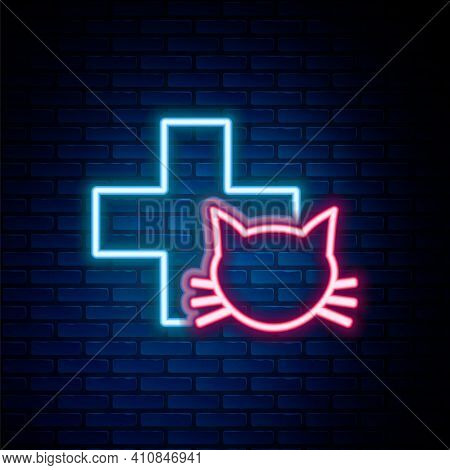 Glowing Neon Line Veterinary Clinic Symbol Icon Isolated On Brick Wall Background. Cross With Cat Ve