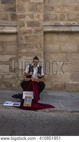 Toledo, Spain, July 2020 - A Busker Playing Music In The City Of Toledo, Spain