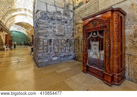 JERUSALEM, ISRAEL - JULY 14, 2019: Interior view of Cave Synagogue - old sacred place for Judaism, part of famous Western Wall (aka Wailing Wall or Kotel) in Jerusalem, Israel.