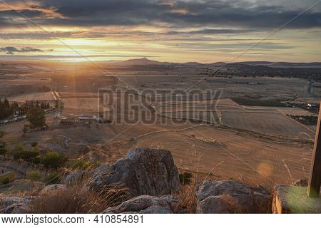 Small Andalusian Town In Southern Spain Photographed From The Top Of A Mountain With Clouds