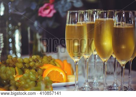 Buffet. The Dining Room Is Full Of Glasses Of Sparkling White Wine With Canapes And Antipasti In The