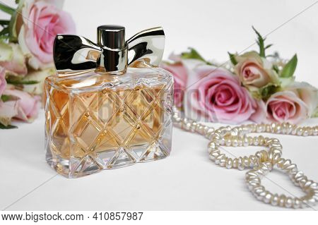 Perfume Bottle With Rose On A Light Background. Perfumery, Cosmetics, Fragrance Collection.
