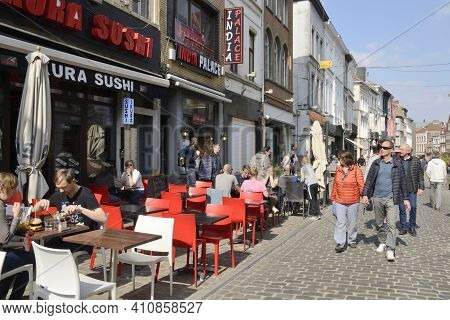 Ghent, Belgium - March 31, 2019: People At Animated Cobbled Street In The Old Town Of  Ghent,  The C