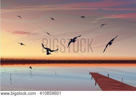 Bright Realistic Sunset Over The Lake With A Pier In The Background. Birds Fly In The Foreground. Be