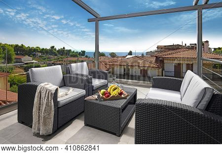 Recreation Concept Panorama Of Modern Patio With Wicker Grey Rattan Furniture. Contemporary Armchair
