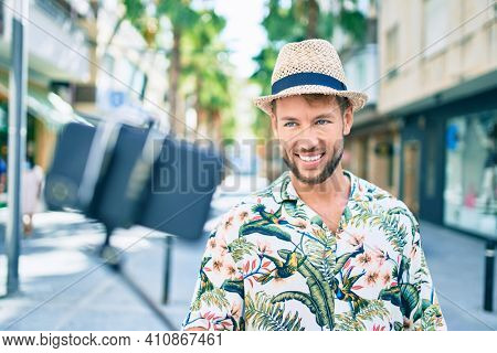 Caucasian handsome man smiling happy outdoors taking a selfie using selfie stick