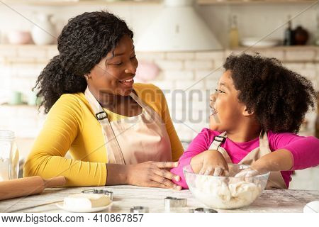 Black Mom And Little Daughter Baking In Kitchen, African American Family Preparing Dough For Cookies