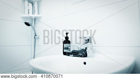 Modern faucet with wash basin sink bathroom interior . High quality photo