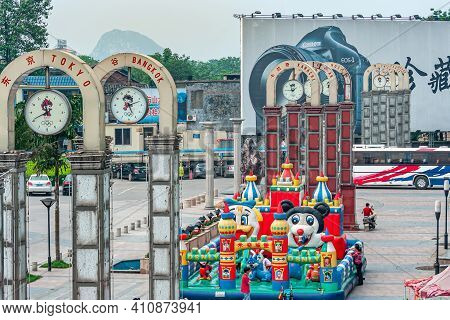 Guilin, China - May 11, 2010: Colorful Jump Castle And Playground On Square With 8 Different City Ti