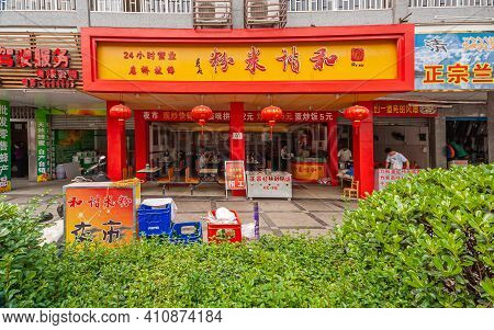Guilin, China - May 11, 2010: Chinese Fast Food Restaurant Serves Breakfast Along Shopping Street An