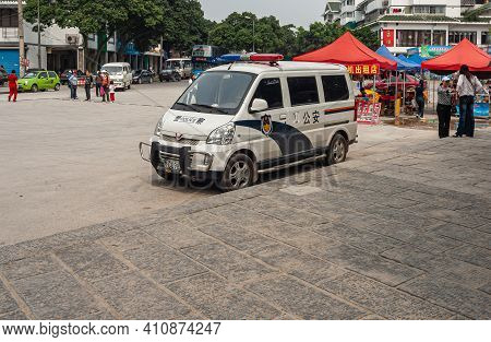 Guilin, China - May 11, 2010: Seven Star Park. White-blue Police Van Parked In Front Of Entrance To