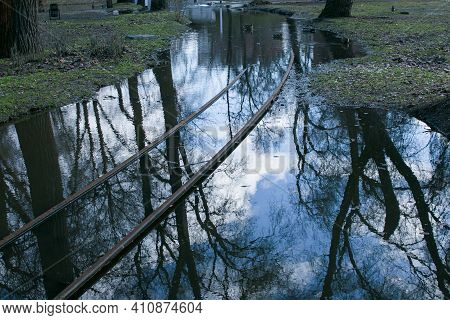 Spring. The Snow Melts, The Water Level In Rivers And Lakes Rises. Flooding In The Park. The Tram Ra