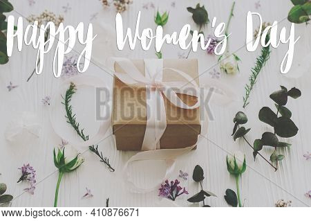 Happy Womens Day Greeting Card. Stylish Handwritten Text Sign On Gift Box With Lilac And Roses Flowe