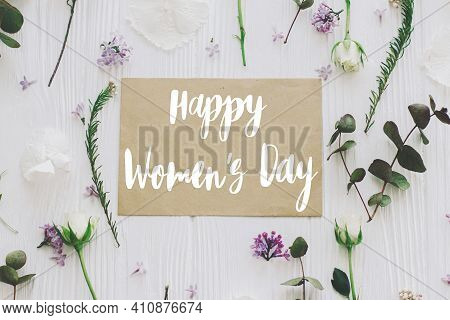Happy Womens Day Greeting Card. Stylish Handwritten Text Sign On Paper Card And Lilac, Roses And Euc