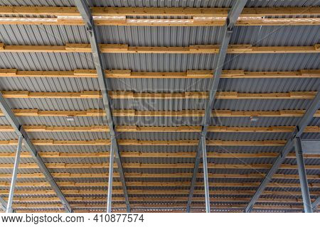 The Roof Structure Of A Large Hangar Consists Of A Steel Frame And Timber Floor Joists. Construction