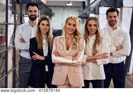 Group Of Young Business People Are Working Together In Modern Office With Laptop, Tablet, Smart Phon