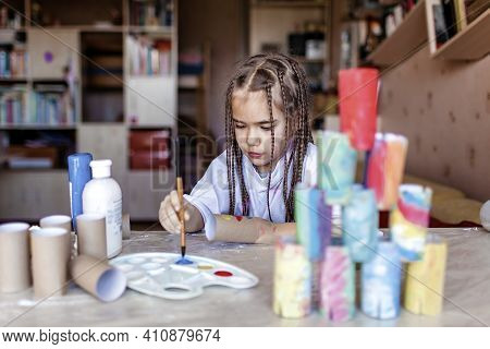 Cute Girl Coloring Toilet Paper Rolls To Use Them As If Paper Blocks To Build A Tower, Home Activity