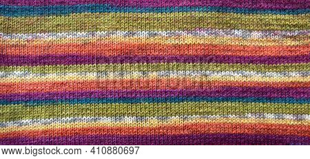 Knit Pattern. Close-up Of Knitted Wool Texture. Colored Pattern Knit As Background.